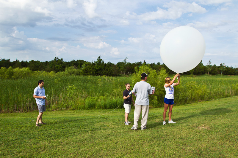 Students launching a weather balloon.